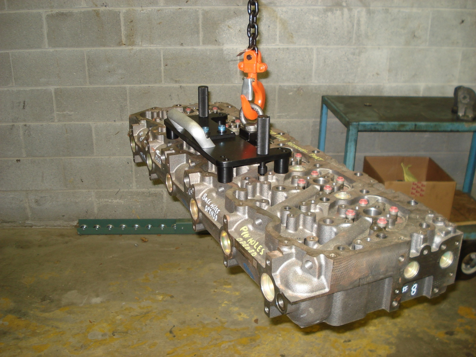 Lift Hook to transfer a 300 pound Cylinder Head from the main assembly line to a repair cart.