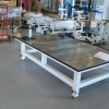 Transmission repair table with adjustable legs and perimeter oil drip trough.