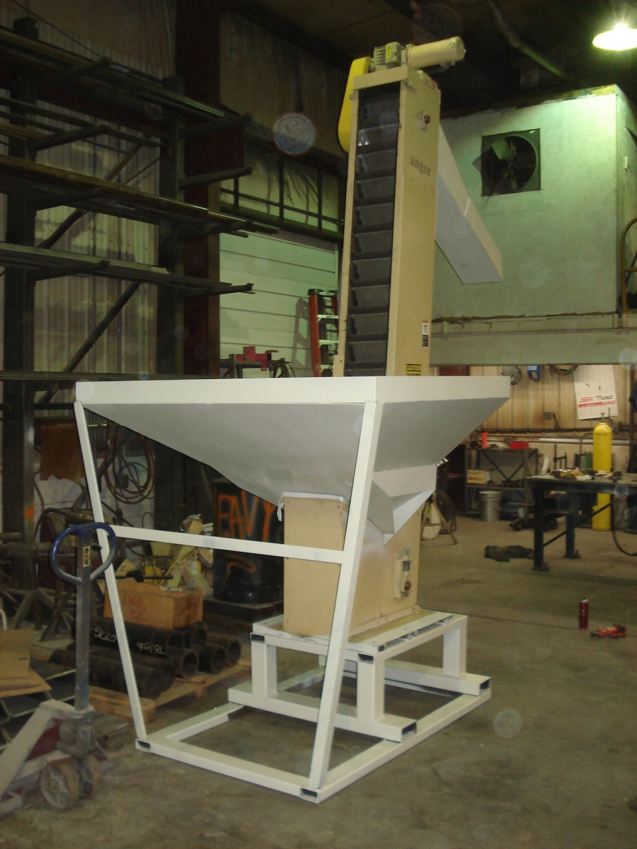 The riser and additions made to an existing hopper/elevator are in white.